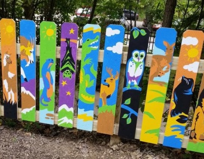 Finished Pgh. Zoo fence design Kids Kingdom, painted by volunteers 2015